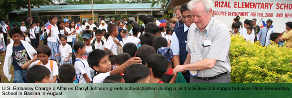 U.S. Embassy Chargé d'Affaires Darryl Johnson greets schoolchildren during a visit to EQuALLS-supported Jose Rizal Elementary School in Basilan in August.