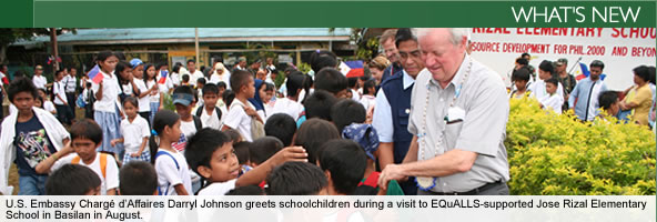 U.S. Embassy Chargé d'Affaires Darryl Johnson greets schoolchildren during a visit to EQuALLS-supported Jose Rizal Elementary School in Basilan in August